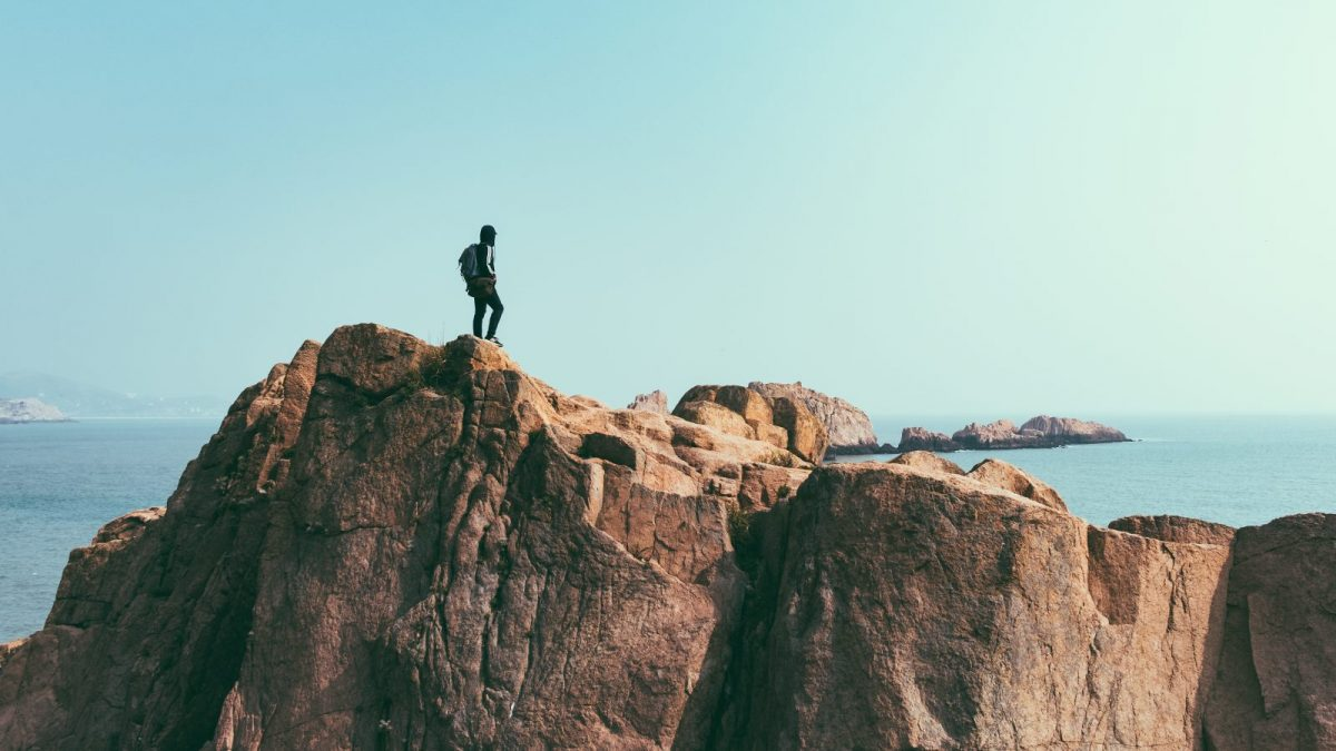 Photo of person on a cliff